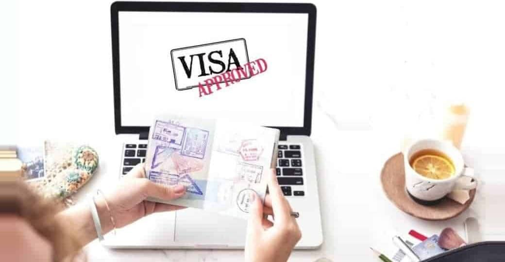Consulate agent holding passport with student visa approved