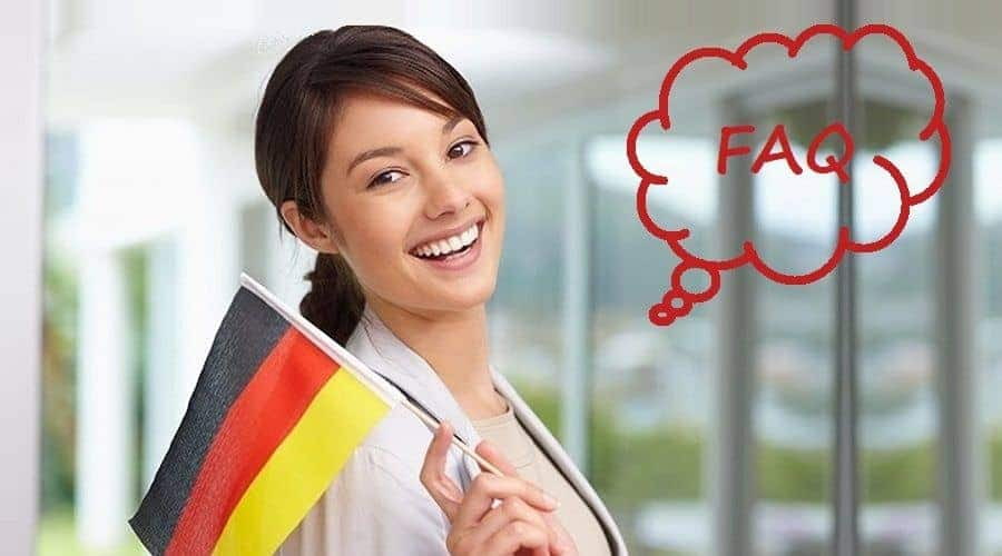 Student holding German flag and thinking about study in Germany FAQ